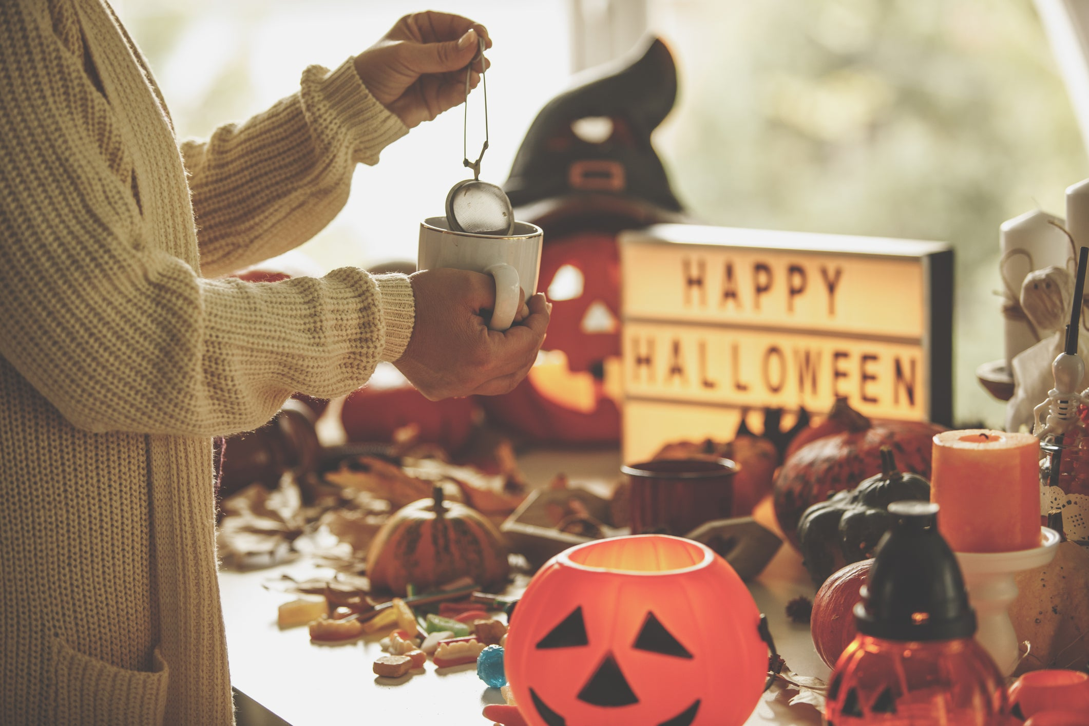 person in sweater during halloween with tea rich in vitamin c