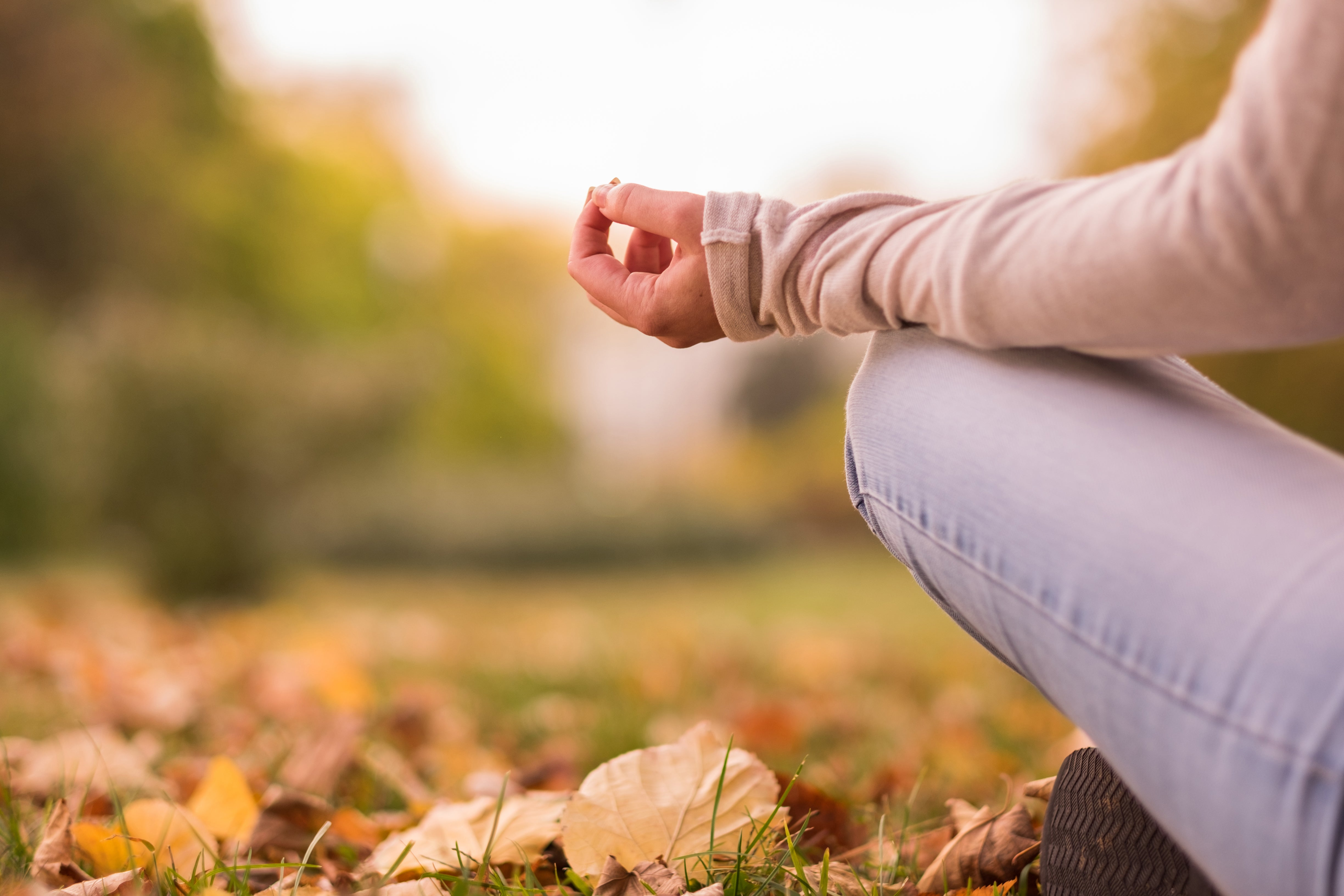 person doing yoga and breathing exercises to improve wellness