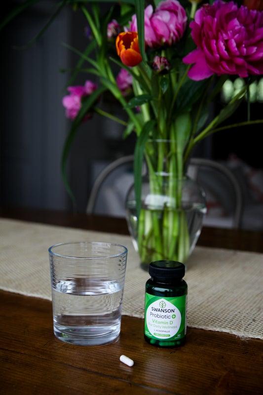 Probiotics in front of a vase