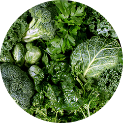 dark leafy greens are a good food to eat to promote healthy skin