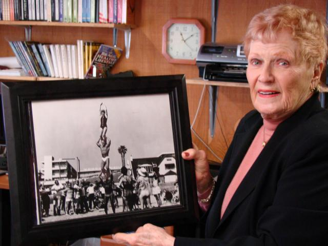Elaine LaLanne shows a photo of herself atop a human pyramid at Muscle Beach